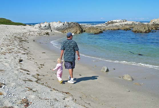 Walking on the beach with Daddy