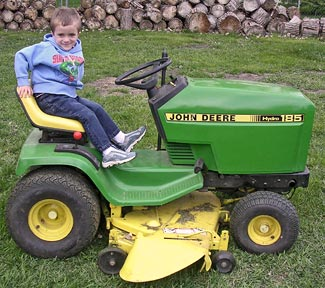 Jayce on tractor mower